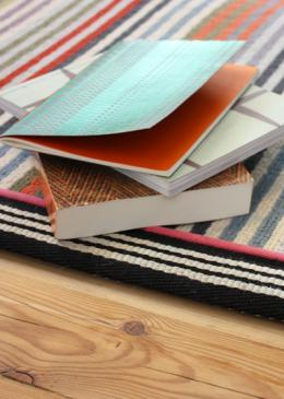 Margo Selby Make Me A Rug: Margo Selby Stripe Frolic Westbrook (1921) with Stripes Thick Borders Black (6203) outer and Cotton Borders Pink (1030) inner border (Double piping) lifestyle shot 2